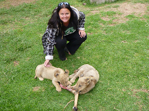 Kristina with lion cubs